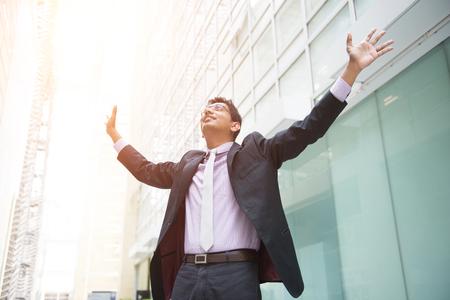 success man: indian male business man celebrating success Stock Photo