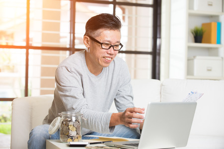matured: asian matured male paying bills online