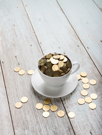 cup of coffee with gold coins of malaysian ringgit Stock Photo
