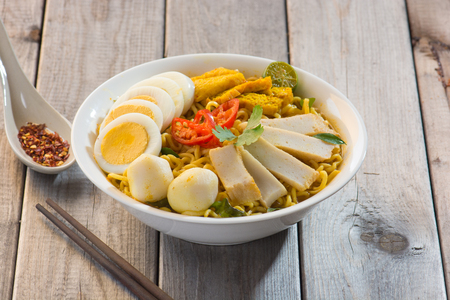 malaysia culture: Curry Laksa which is a popular traditional spicy noodle soup from the Peranakan culture in Malaysia and Singapore