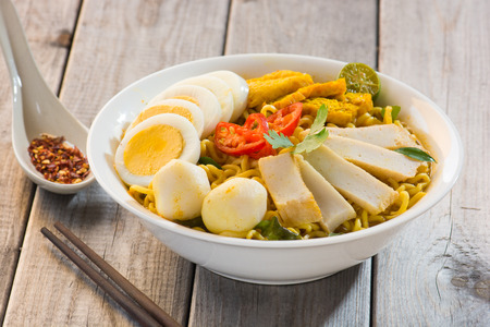 Curry Laksa which is a popular traditional spicy noodle soup from the Peranakan culture in Malaysia and Singapore 免版税图像 - 53825602