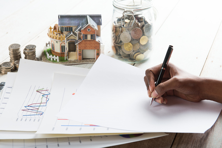 single familiy: hand signing property loan agreement concept