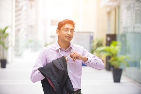 people relax: indian business male relax and taking off necktie Stock Photo