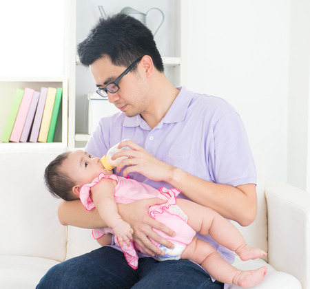 asian father nursing Stock fotó