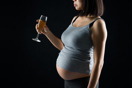 pregnant mother drinking