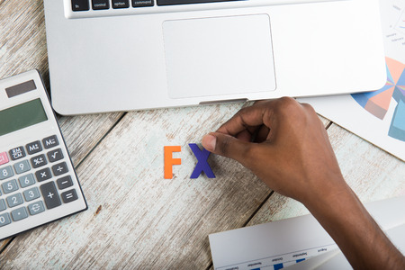 fx: fx words with hands arrangement and financial concept Stock Photo