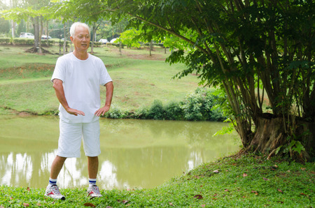 chi kung: asian senior man performing tai chi