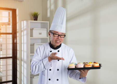 matured: matured asian male chef