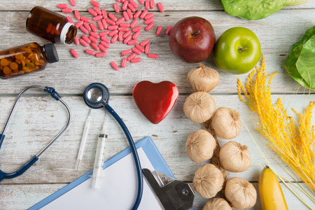 healthcare concept balance between medicine and healthy foods