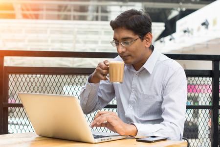 coffee hour: indian business male having milk tea