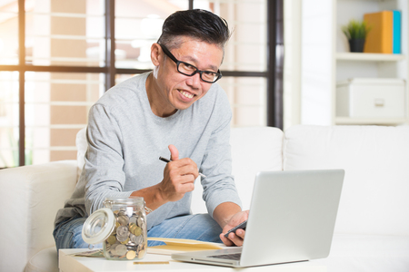cashflow: matured asian male with finance concept photo Stock Photo