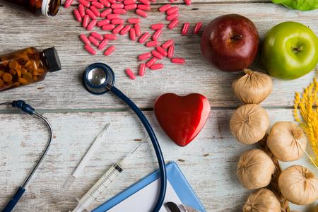 bad apple: healthcare concept balance between medicine and healthy foods