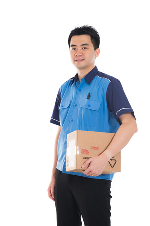 happy worker: asian delivery male Stock Photo