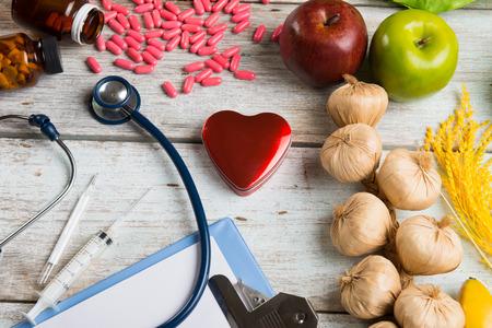 healthcare and medicine: healthcare concept balance between medicine and healthy foods