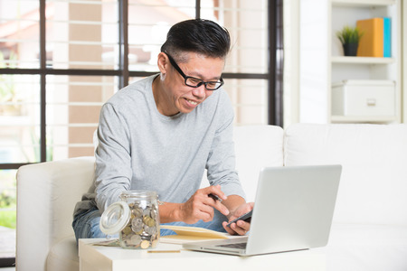 matured: matured asian male with finance concept photo Stock Photo