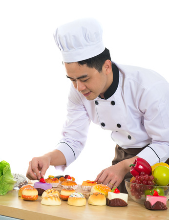 young man portrait: asian male chef