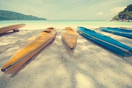ocean fishing: Fishing boat at beautiful sandy ocean palm beach, vintage tone