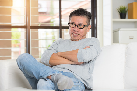 matured asian male sitting Stock Photo
