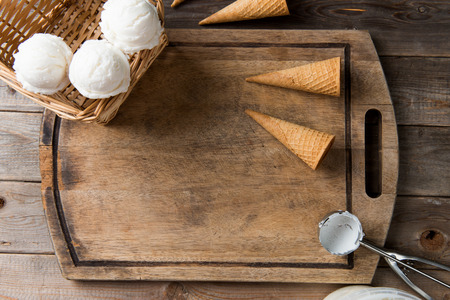 gourmet kitchen: creamy vanilla ice cream in preparation with rustic background and copyspace