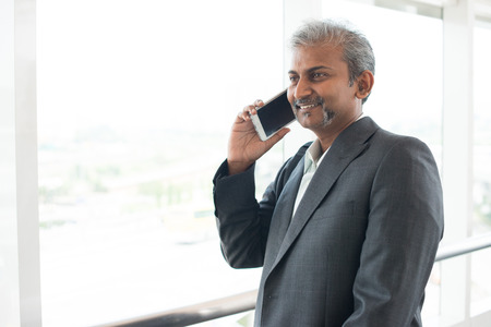 men talking: matured indian business male on phone conversation