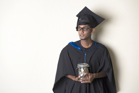 college fund savings: indian male having problems raising education funds concept photo