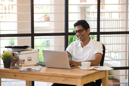 casual business man: casual indian male working at office Stock Photo