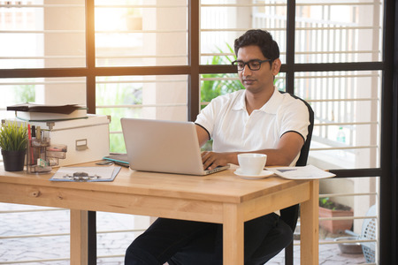 pakistani ethnicity: casual indian male working at office Stock Photo
