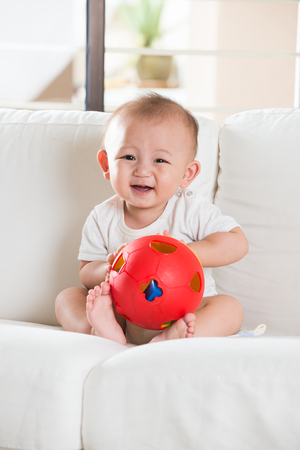 baby playing: asian baby playing with ball Stock Photo