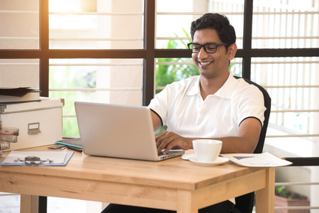 laptop computer: young indian man working from home office Stock Photo