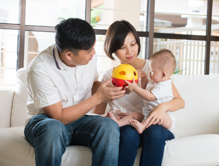 asian family home: Happy Asian Family Playing with baby in the living room