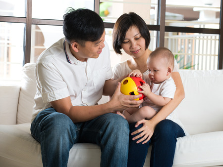 chinese lady: asian parent playing educatio toy with baby Stock Photo