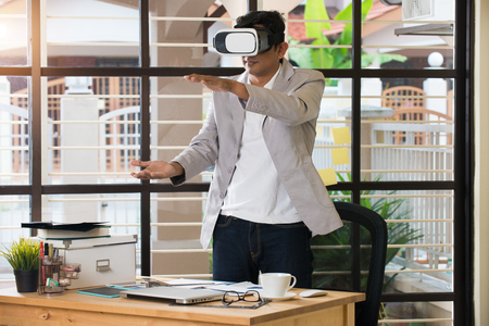 india 3d: indian male using virtual reality technology at work Stock Photo