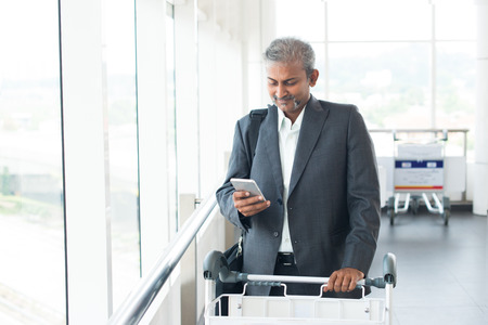 asian business man: indian business male travelling at airport Stock Photo