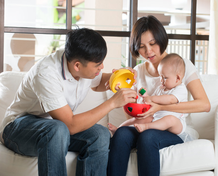 baby love: asian parent playing educatio toy with baby Stock Photo