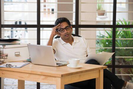 indian male having headache
