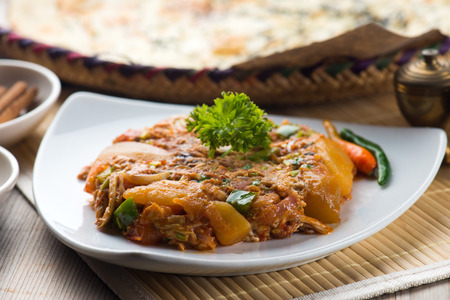 oqda popular arab food, fried potatoes with meat