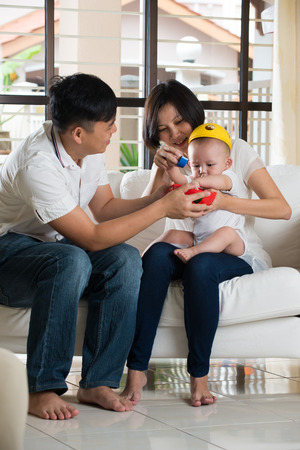 baby playing: asian parent playing education toy with baby Stock Photo