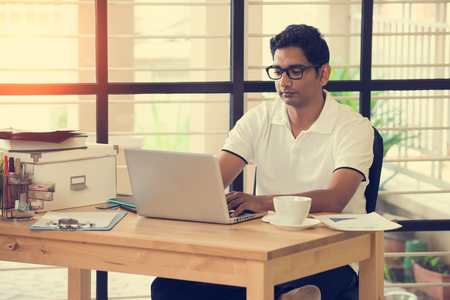 man working computer: indian man working at office