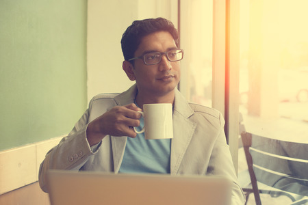 alone person: indian male drinking coffee Stock Photo