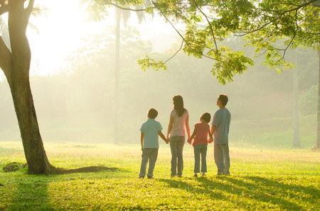 asian family walking outdoor in the morning photo