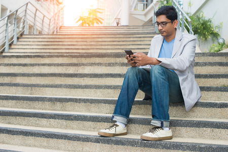 using phone: indian male using phone