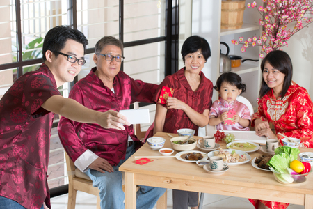 reunion dinner: Chinese new year reunion dinner, part of Chinese culture to gather during eve Stock Photo