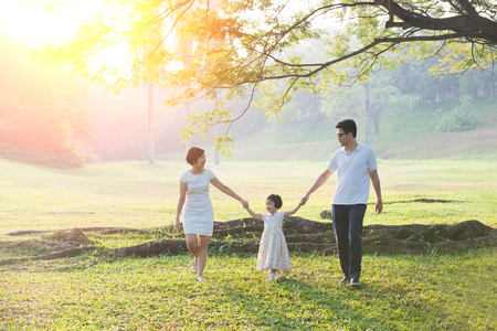 Happy Asian Family enjoying family time together in the park Zdjęcie Seryjne - 66519022