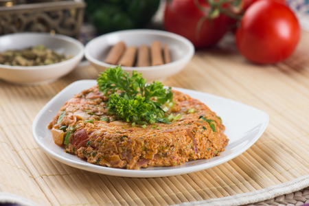 oqda , fried potatoes with meat popular arab food   Stock Photo