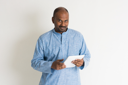 kurta: traditional indian male using tablet indoor Stock Photo