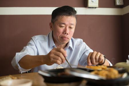 bah: asian matured male eating bah kut teh