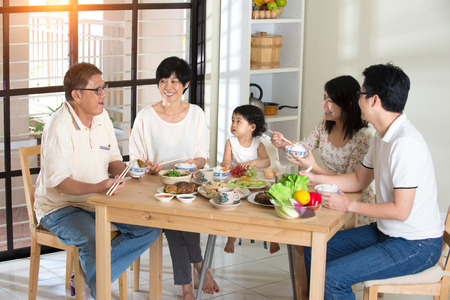 having lunch: chinese family having lunch Stock Photo