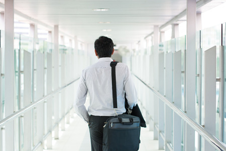 business traveller: indian business male walking at airport Stock Photo
