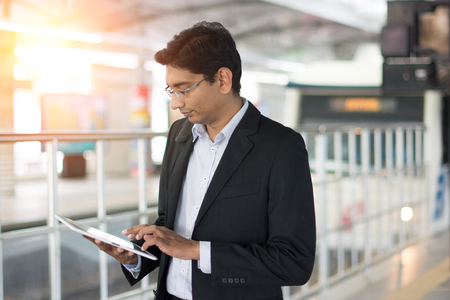 indian male using tablet