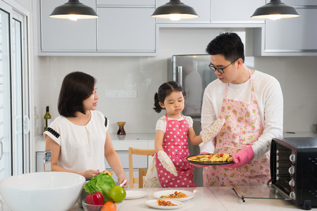 family together: asian family baking at kitchen